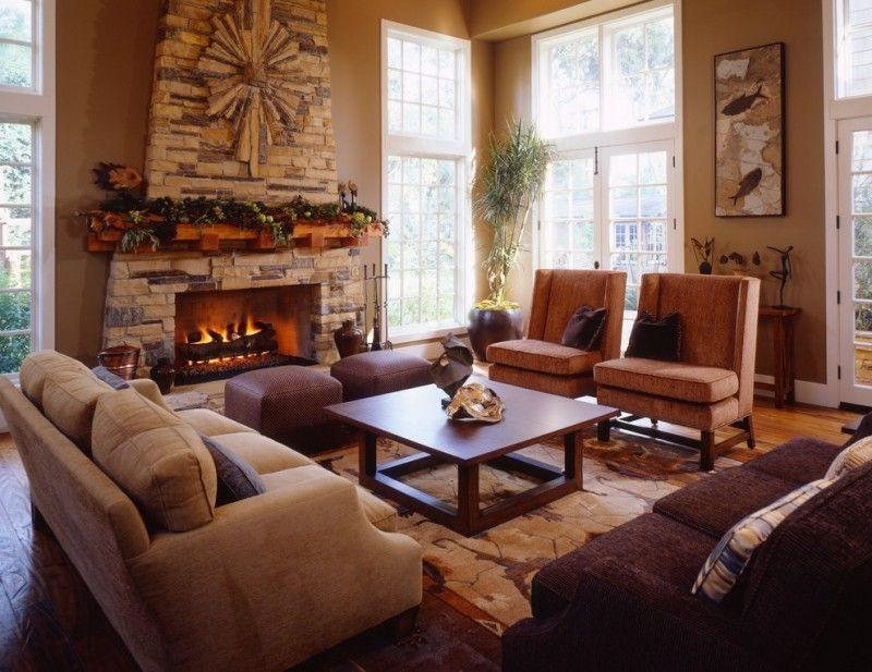 mission styled living room with stone finished fireplace a couple of