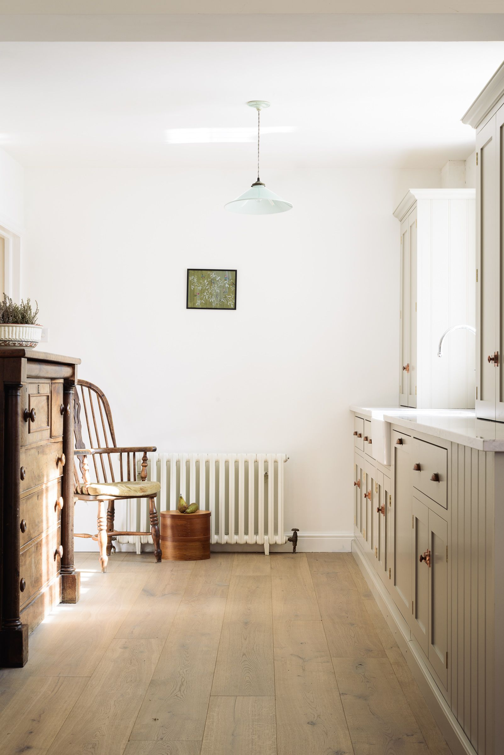 Our new surrey kitchen features simple white walls and mushroom