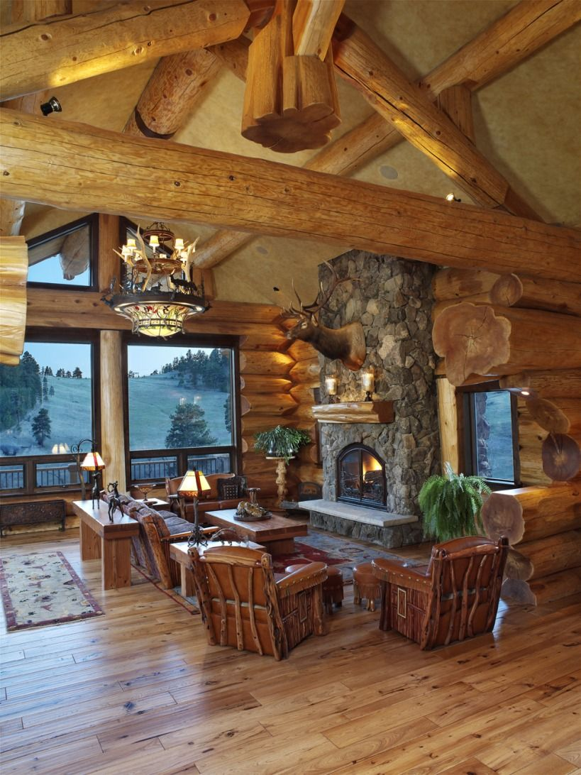 Saddle notch ranch log great room with stone fireplace for Rustic log house