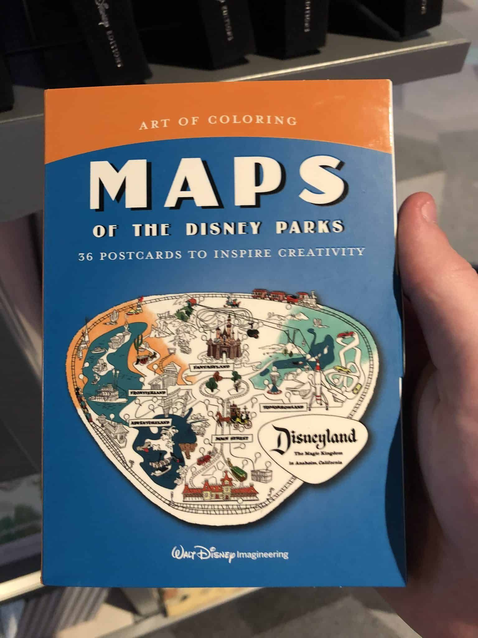 Photos Poster Art Of The Disney Parks And Maps Of The Disney Parks Coloring Books Arrive At Epcot Wdw News Today Coloring Books Disney Parks Poster Art