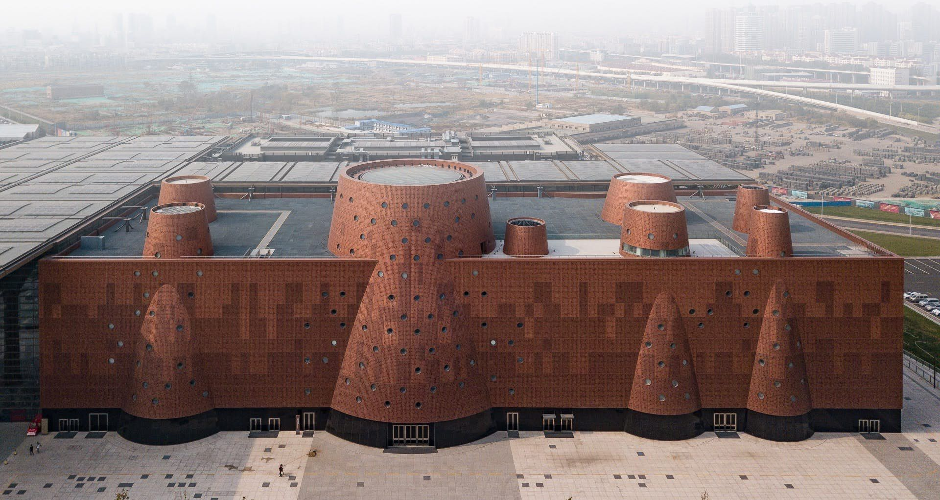 The Exploratorium Measures 33 000 Sq M 355 200 Sq Ft And Is Finished In An Eye Catching Reddish China Architecture Bernard Tschumi Architecture