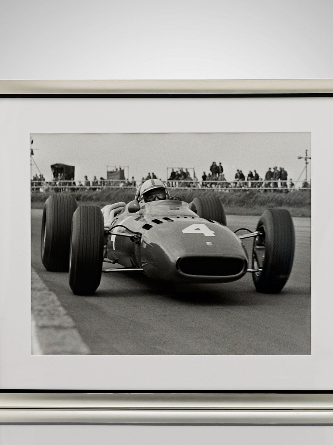 This limited-edition print supplied by Getty Images was shot in 1966 and features British race-car driver John Surtees driving a Ferrari at Silverstone Circuit, in England.