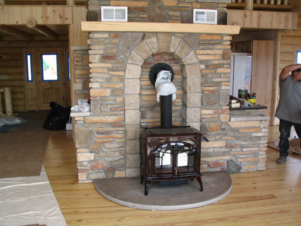 Wood Stove Hearth Designs - What a nice cultured stone hearth for a wood stove can t forget about that amazing colored concrete