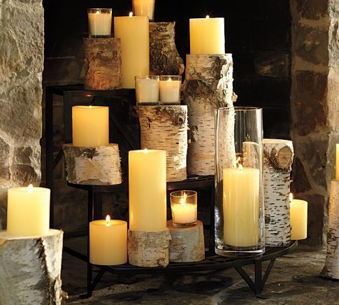 So many great ideas for non working fireplace! Candles on top of birch logs.