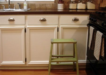 add trim to the front of kitchen cabinet doors to give more