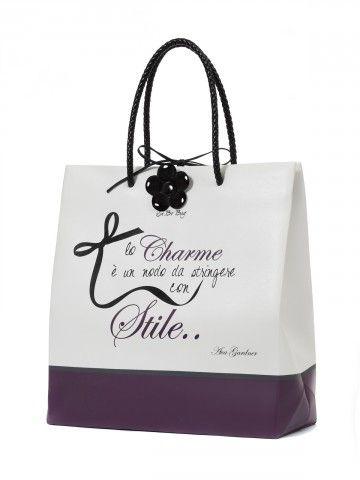 Borsa Le Pandorine linea Sa.bo. - Shopping bag in poliuretano espanso opaco con doppi manici in ecopelle intrecciata.Grafica:lo charme è un nodo da stringere con stile..Colore:White