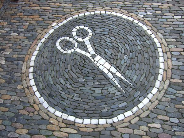 Sidewalk Mosaic in the small German/Swiss border town of Laufenburg which is divided by the Rhine & connected by bridge, allowing people to easily stroll back & forth from Germany to Switzerland.