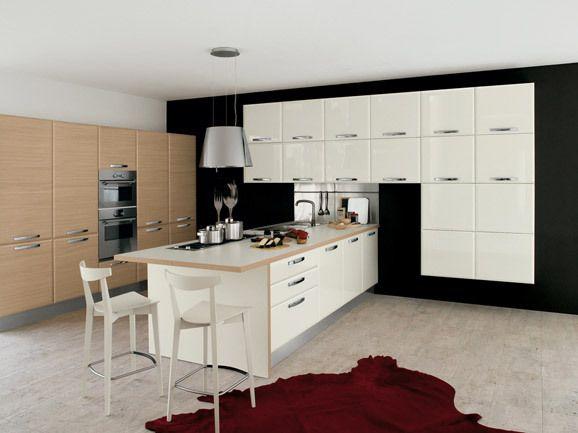 Cucina angolare con anta a rovere e bianco