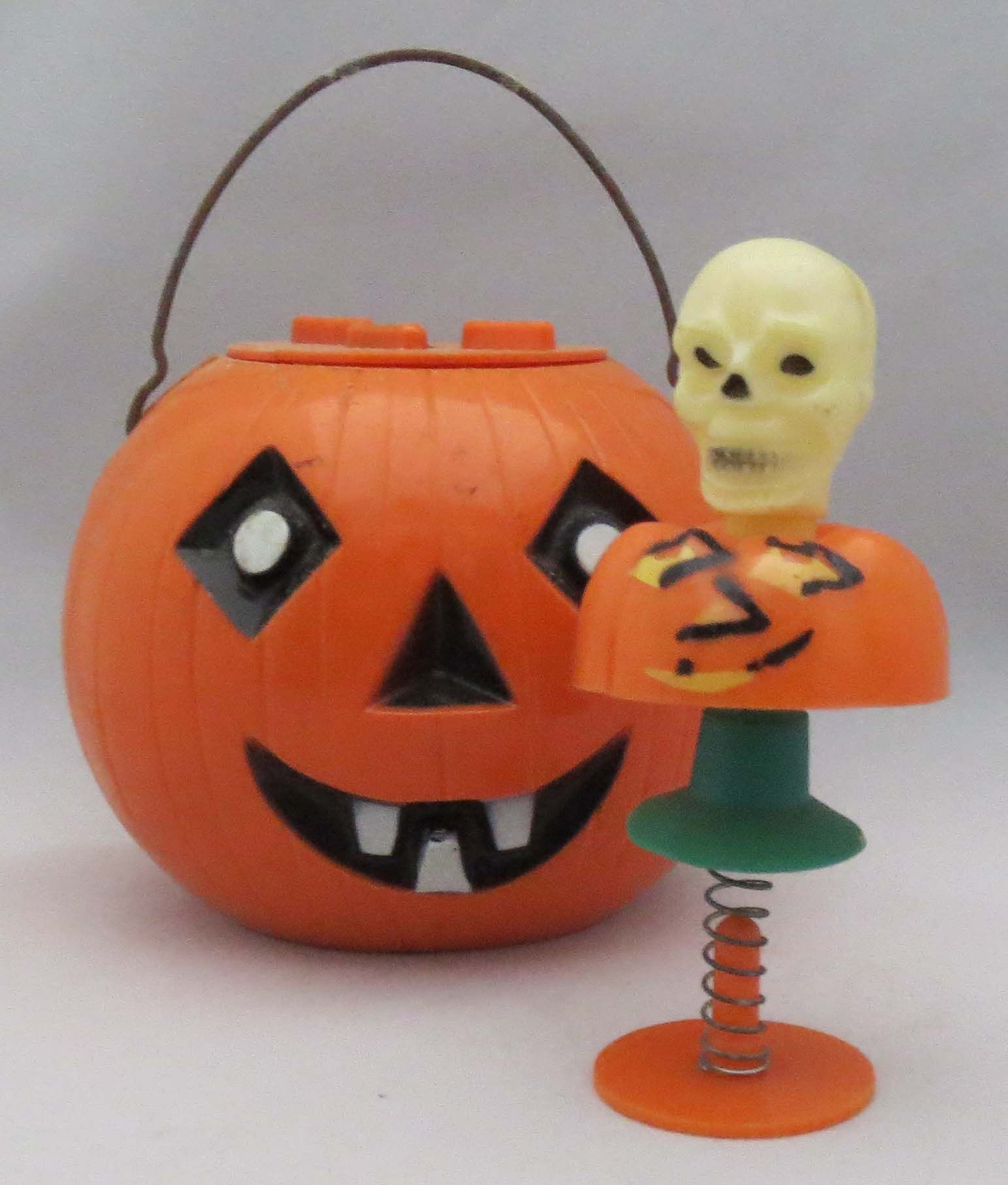 Hard plastic JOL lantern and skull suction cup pop-up.