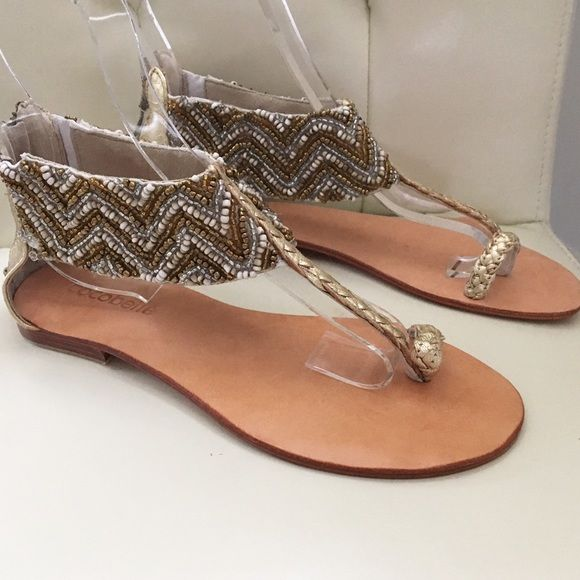 Cocobelle Gold Zig Zag Beaded Sandal Leather thong with toe loop and African embellished beadwork, suede lining, zip closing on full leather sole.  Size 6.5/37. Handmade in Bali. New without tags. Cocobelle Shoes Sandals