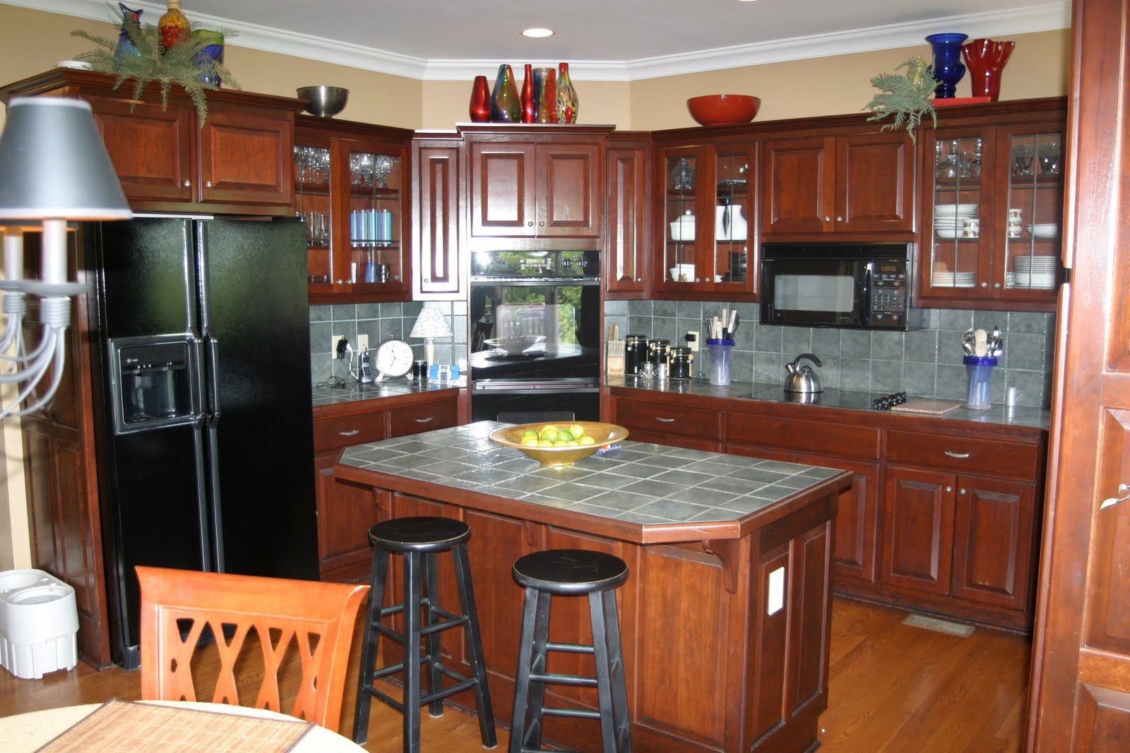 Like the paint color colors for kitchens with cherry for Kitchen colors cherry cabinets