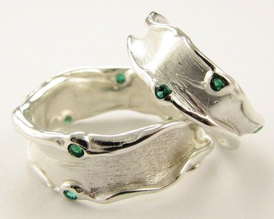 I love this set for so many reasons...the fluidity of it (made from a mold of melted wax) ... the deep green of the stones flashing against the silver...the textures...oh my...