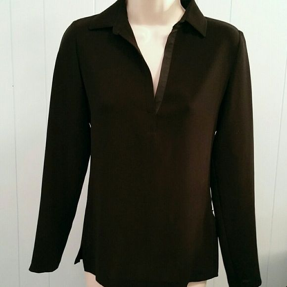 Tahari Long Sleeve Black Top Very neat looking fitted top.  Hidden zipper on the side, needed because it's so fitted in the back.  Light smooth material.  Will lay nice on your body.  Made from 100% polyester.  In great condition,  no tears,  snags or stains. Tahari Tops