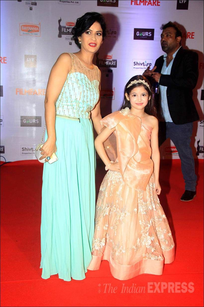 Harshaali Malhotra with her mother on the red carpet at the Filmfare Awards show. #Bollywood #Fashion #Style #Beauty #Cute