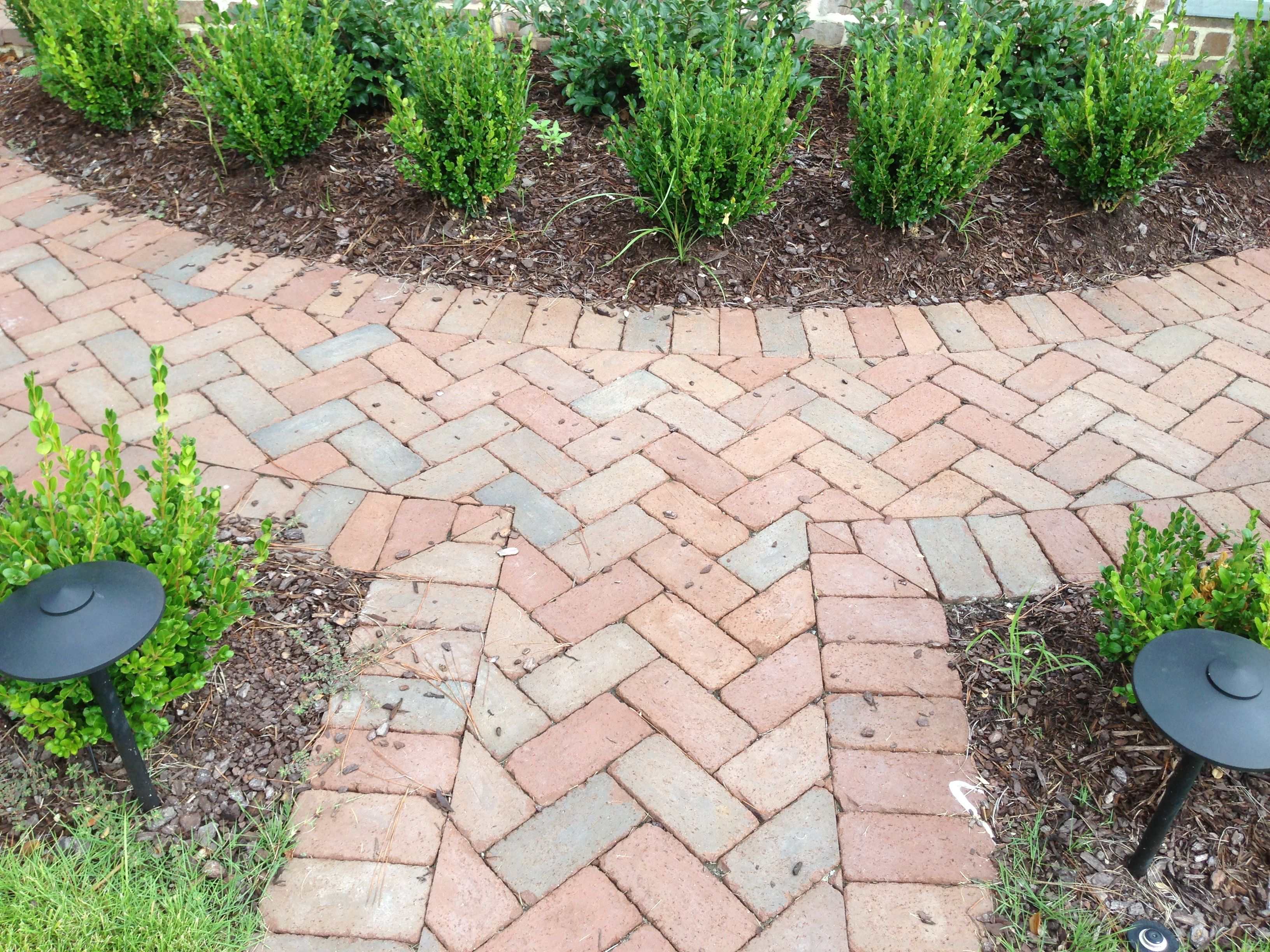 A Rumbled Cocoa Path With An Artfully Merged Herringbone Pattern And Straight Edging Made With Pine Hall Brick Cl Brick Garden Outdoor Landscaping Clay Pavers