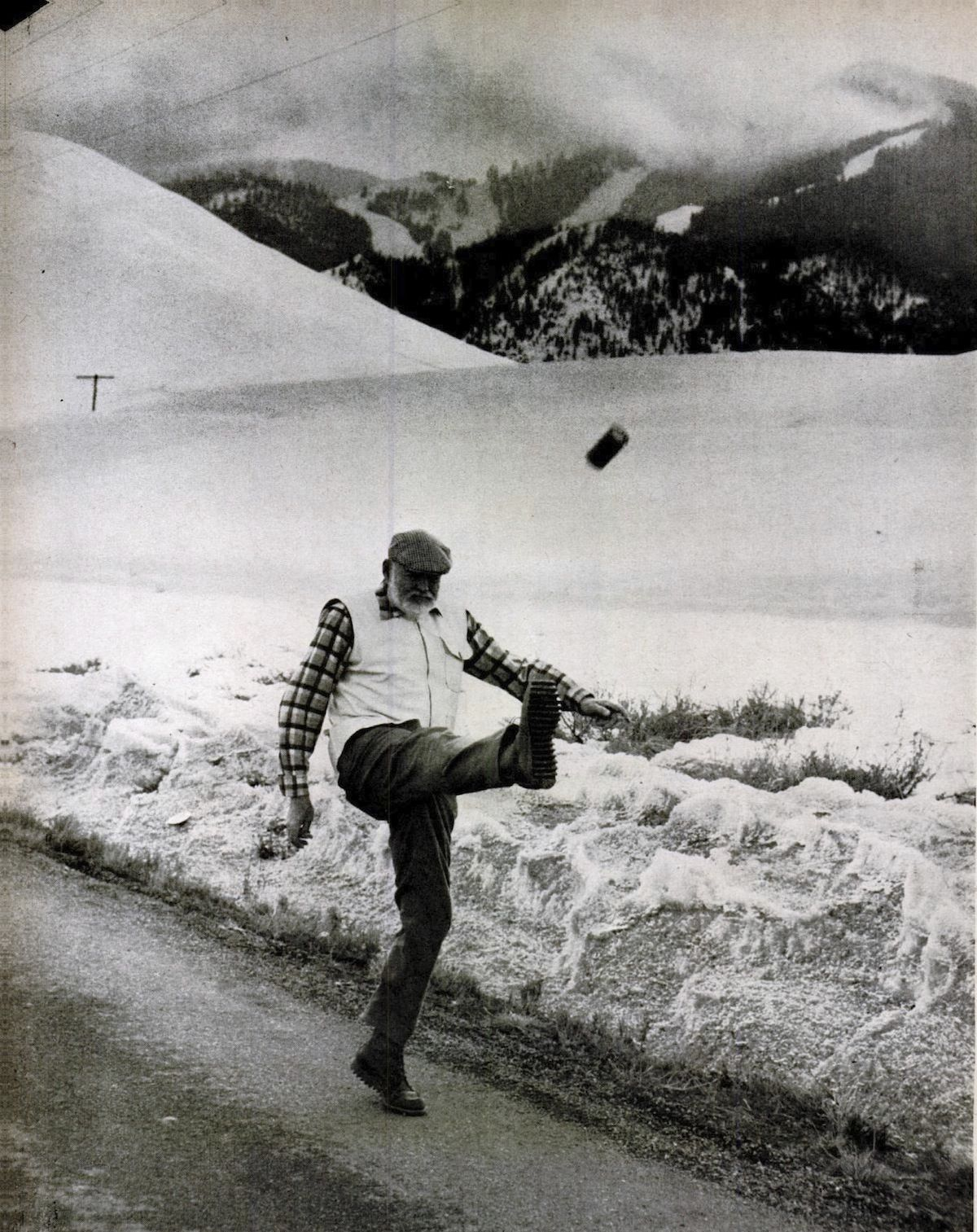 Ernest Hemingway kicking a can of beer by John Bryson, 1959