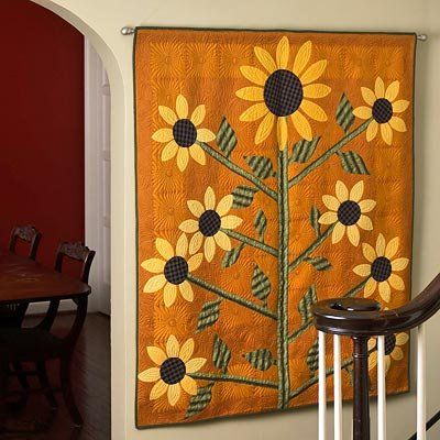 Turn the tables on a vintage tablecloth. Use it as your appliqué foundation!  Then learn to do freezer-paper appliqué to add the sunflower motifs with our  easy-to-follow instructions.