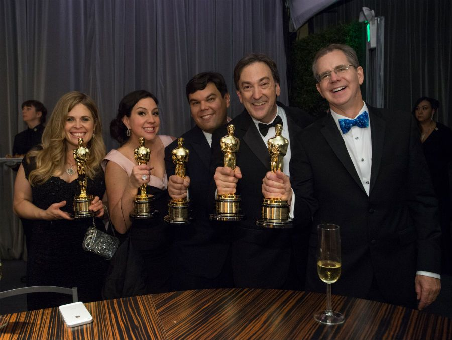 Oscar Jennifer Lee, Kristen Anderson-Lopez, Robert Lopez, Peter Del Vecho and  Chris Buck at the Oscar engraving station.
