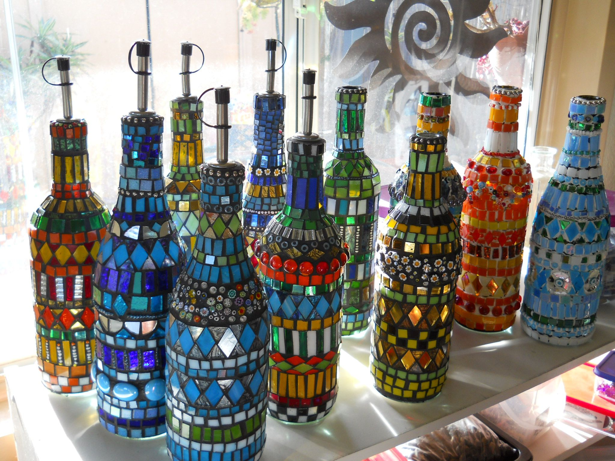 Mosaic bottles glorious this is what i have been gluing for Wine bottle artwork
