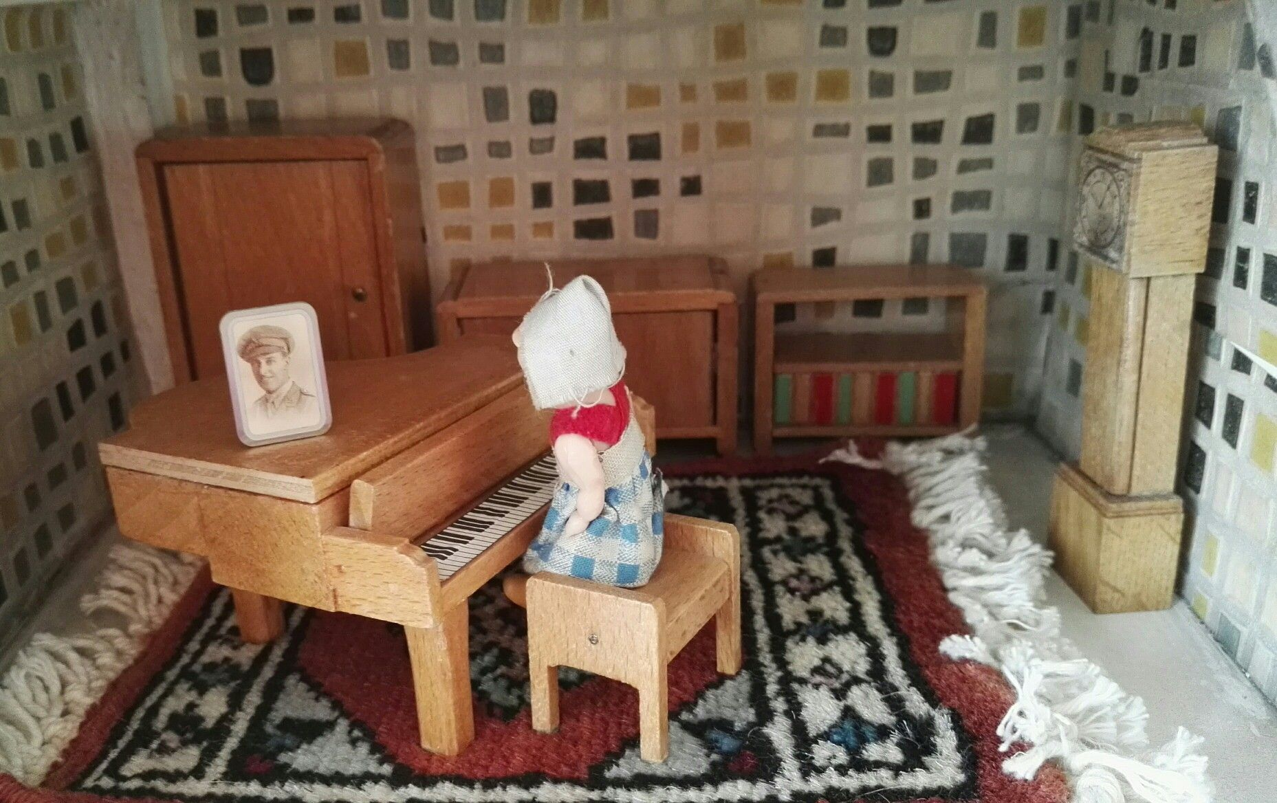My doll's house is a GeeBee DH9 made between 1964 and 1966. My doll's house living room furniture is by A E Twiggs.