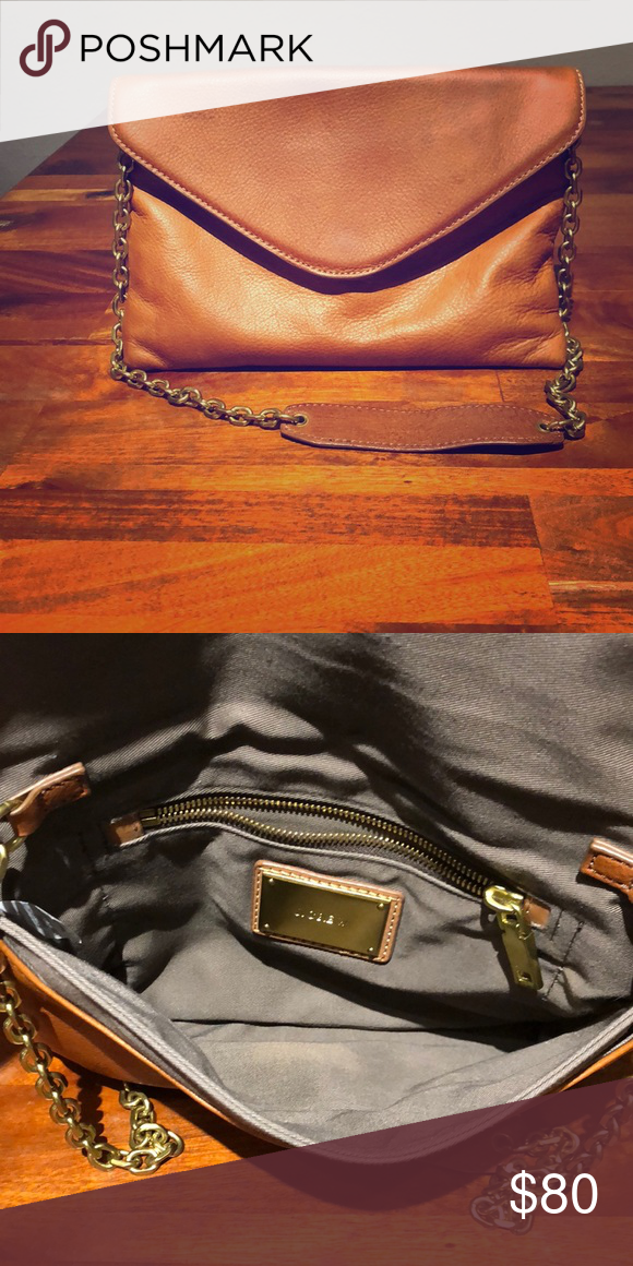0c00e9d90e93 JCrew hand bag Clutch hand bag. From JCrew. Saddle brown with small metal  gold shoulder strap. J. Crew Bags Clutches   Wristlets