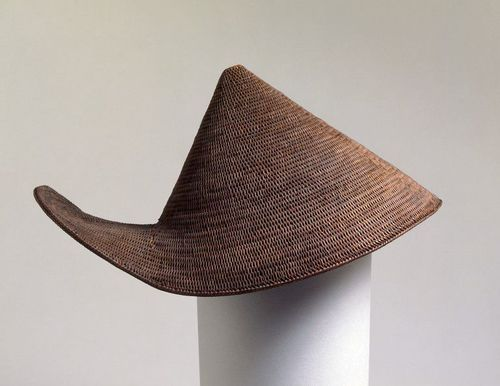 Woven split cane hatwith curved upturned brim at the back.Made of areca palm-leaf, Arunachal Pradesh, India, early 20th century