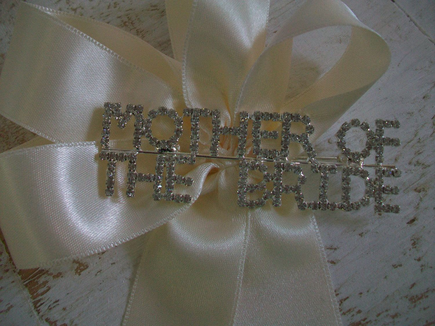 Mother Of The Bride Corsage Brooch Ribbon Pin Party Favor Bridal Shower Gift Rhinestone Crystals. $46.00, via Etsy.
