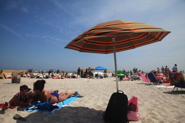 The Traditional Orange Green And Brown Umbrellas That Dot White Sand Of Jones Beach On Long Island Are Life Work One Woman Chris Ann Peters