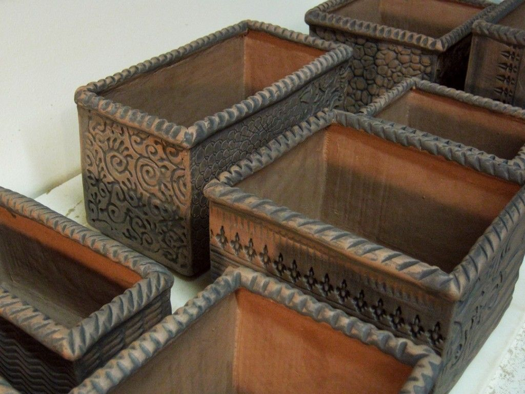 Terra cotta stained planters @Gary Jackson