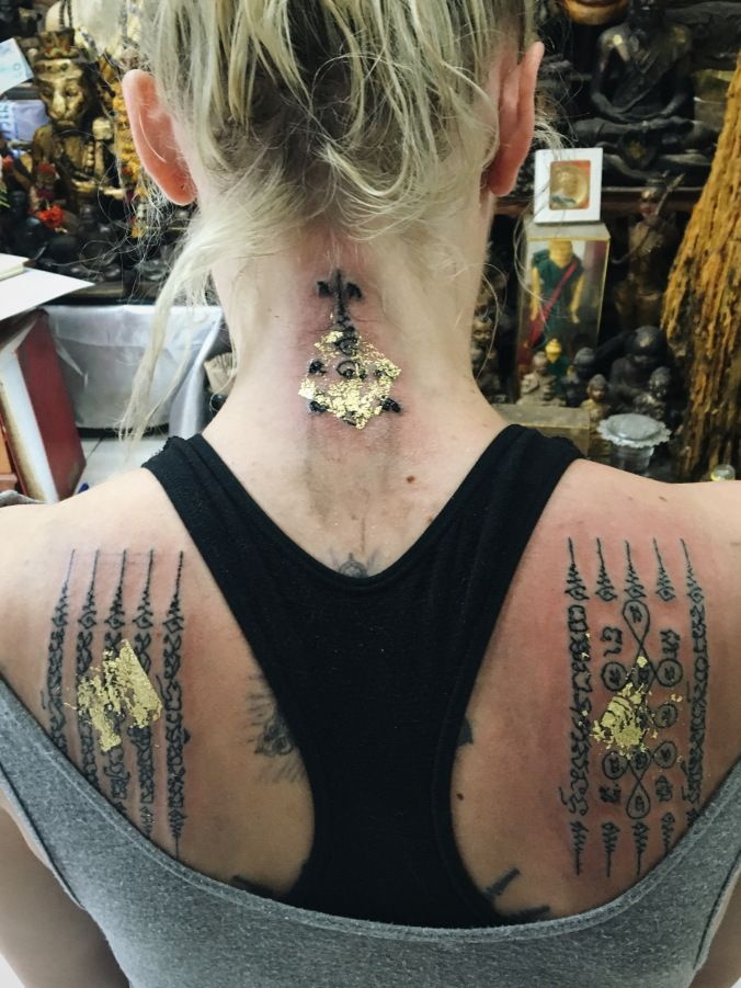 449101554 Sak Yant pressed with gold leaf. | I N K | Ancient tattoo, Gold ...