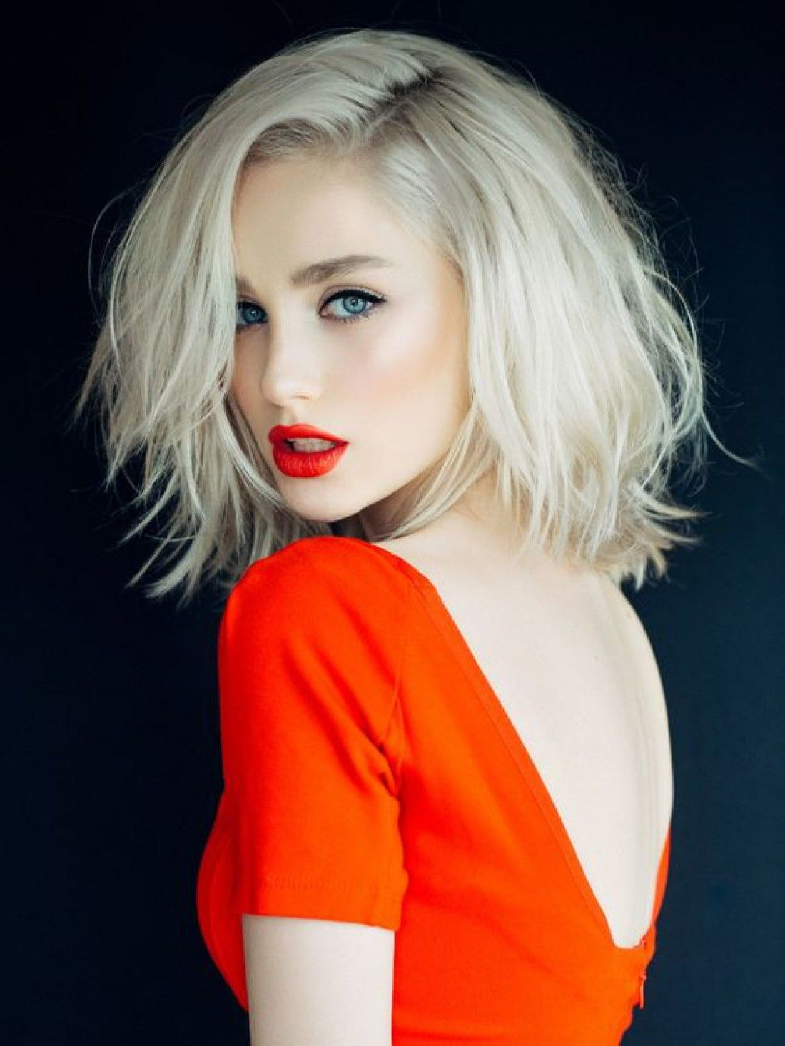 Beautiful Blonde Girl Wearing a Bright Red Top and