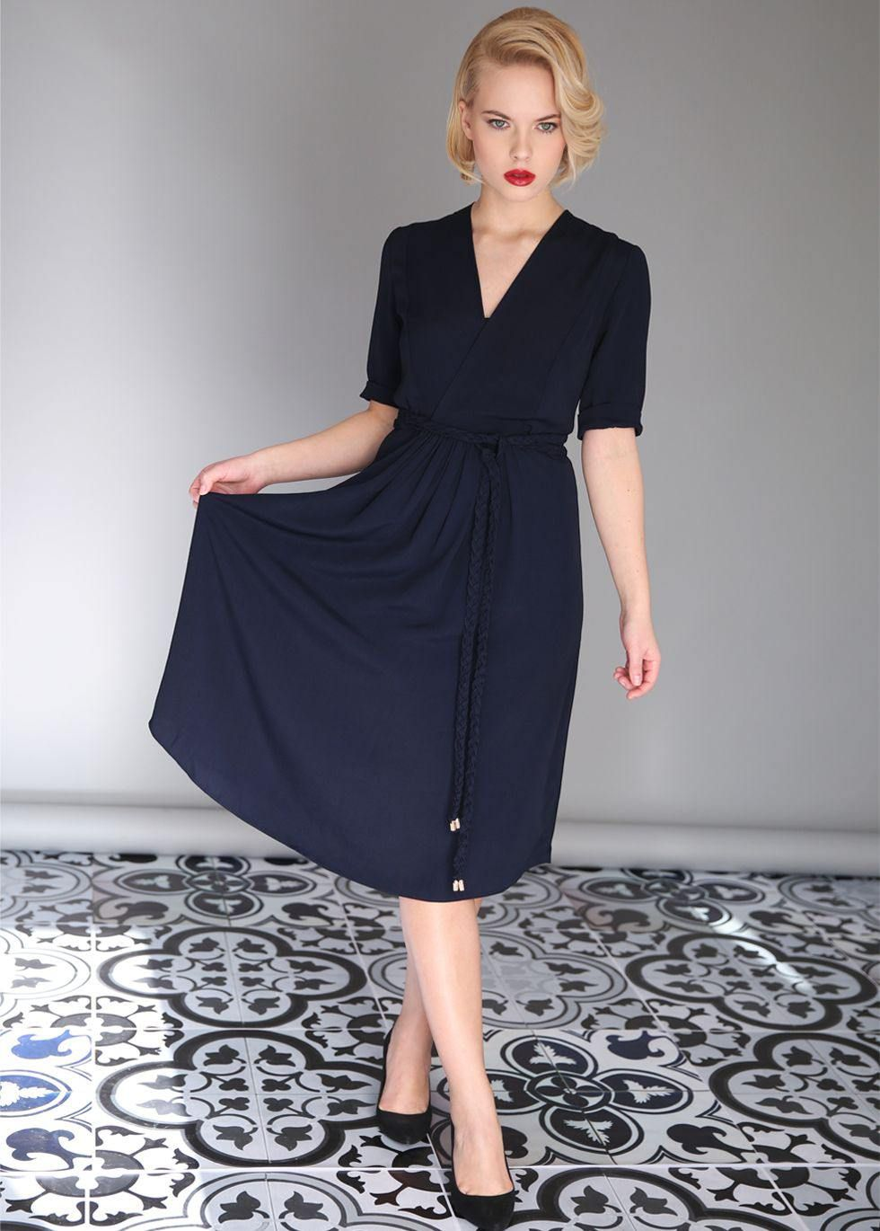 Wrap dress with a closed vneck braided belt with 2 gold