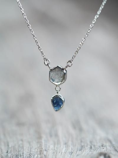 Labradorite and Ceylon Sapphire Necklace is part of Sapphire necklace, Birthstone jewelry, Silver necklace, Diamond necklace, Jewelry, Silver - Remember that magical night, when you and your love were watching the stars  Just the two of you under the big dark sky  Your love seemed endless then, and still is  This necklace holds fiery labradorite to remind you of that magical moment  Labradorite is treasured for its remarkable play of color, known as labradorescence  This greyish stone with black tiny freckles, is composed in aggregate layers that refract light as iridescent flashes of peacock blue, gold and pale green  Labradorite is a base chakra (1st chakra) gemstone and good for stability and grounding  The labradorite has a gorgeous blue flash and lots of sparkle and confetti inside  You'll receive the exact necklace from the photos  The necklace measures 45 5 cm or 18  in length, but can be shortened up to 3 5 cm (1 4 ) with the special extension chain