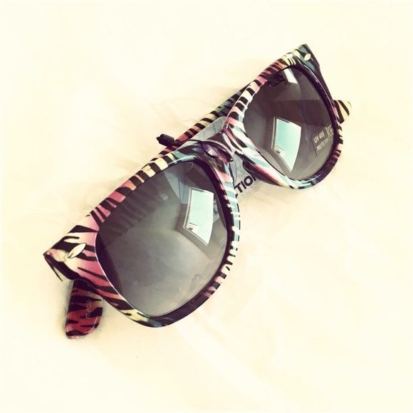 W Collection Multi Color Zebra Wayfarers Fun & comfy pair! UV400  Please ask ALL questions before you buy as all sales are final. I try to describe the items I sell as accurately as I can but if I missed something, please let me know FIRST so we can resolve it before you leave a less than 5rating.   TRADES/OFFLINE TRANSACTIONS LOWBALLING (Please consider the 20% PM fee) 100% Authentic items   &  Free home W Collection Accessories Sunglasses