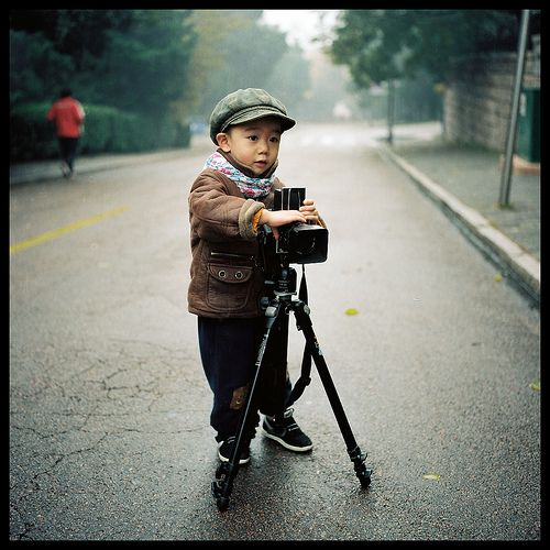 asian baby boys with cameras.