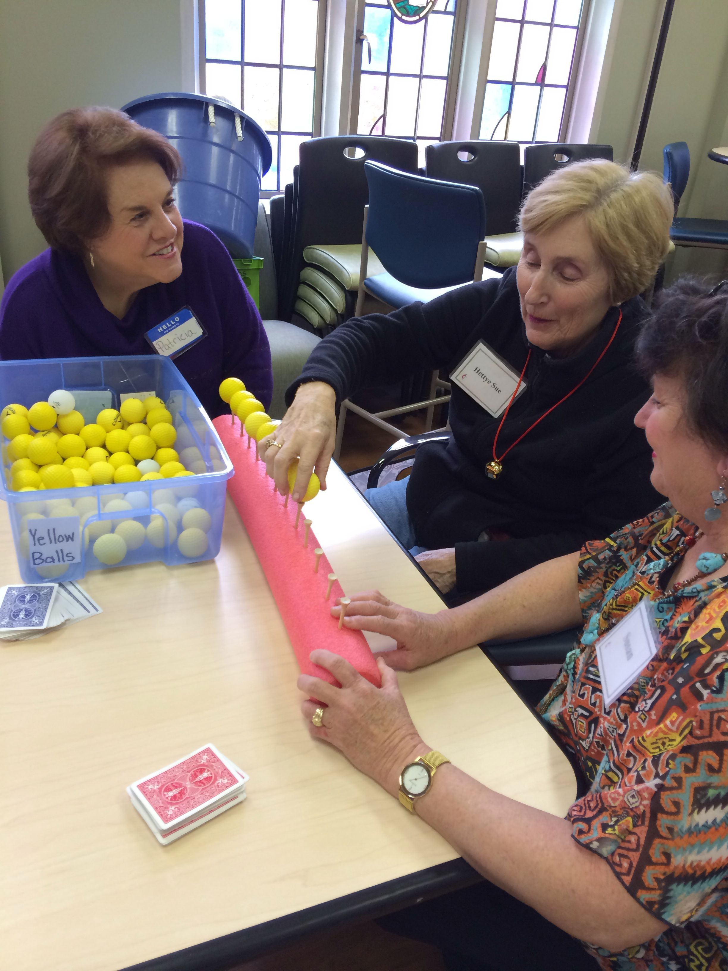 Fine motor fun have client put ping pong balls onto golf tees then