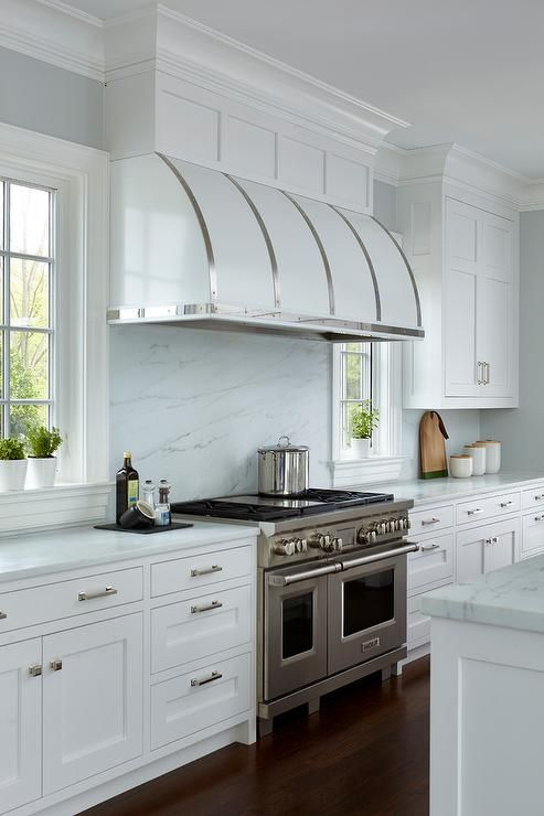 White Barrel Kitchen Vent Hood With Stainless Steel Straps Suggest