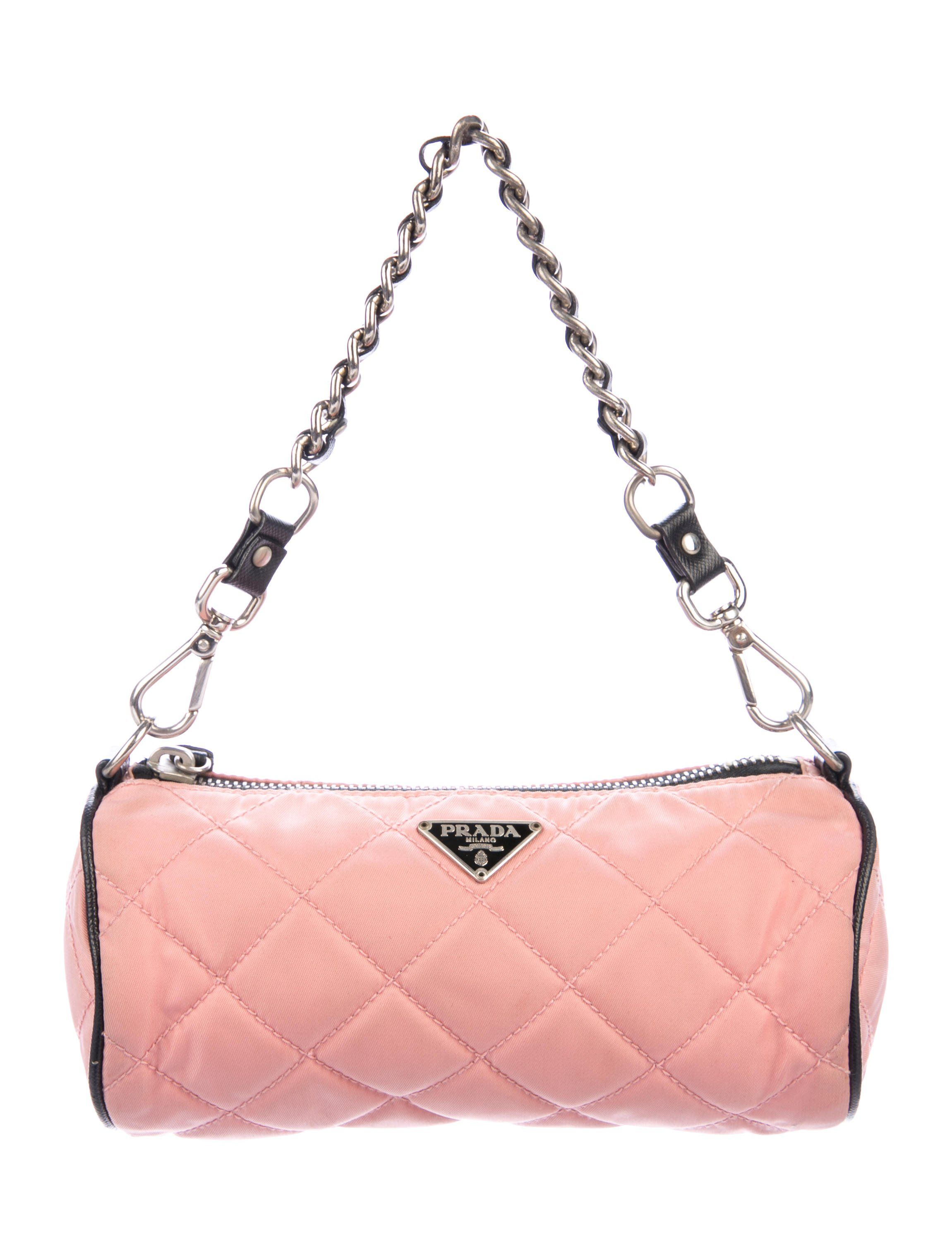 b5c9f6058b72 Pink quilted Tessuto Prada handle bag with silver-tone hardware, black  leather trim, chain-link and leather handle strap, black jacquard lining  and zip clos