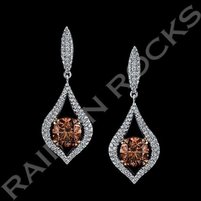 GET FANCY! with this matched pair of 4.10 total carat weight, fancy dark orangey brown round brilliant diamonds, set in 18k White Gold surrounded by colorless melee that sparkle! www.raimanrocks.com#love #engaged #earrings #diamond #fancydiamonds #jewelry #fashion