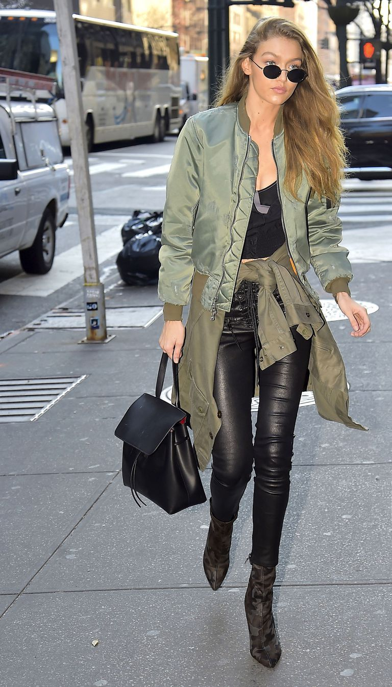 1ad7a28f12 Gigi Hadid Street Style Green Bomber Jacket Crop Top Black Leather Pants  Camo Boots Mansur Gavriel Bag Rounded Sunglasses