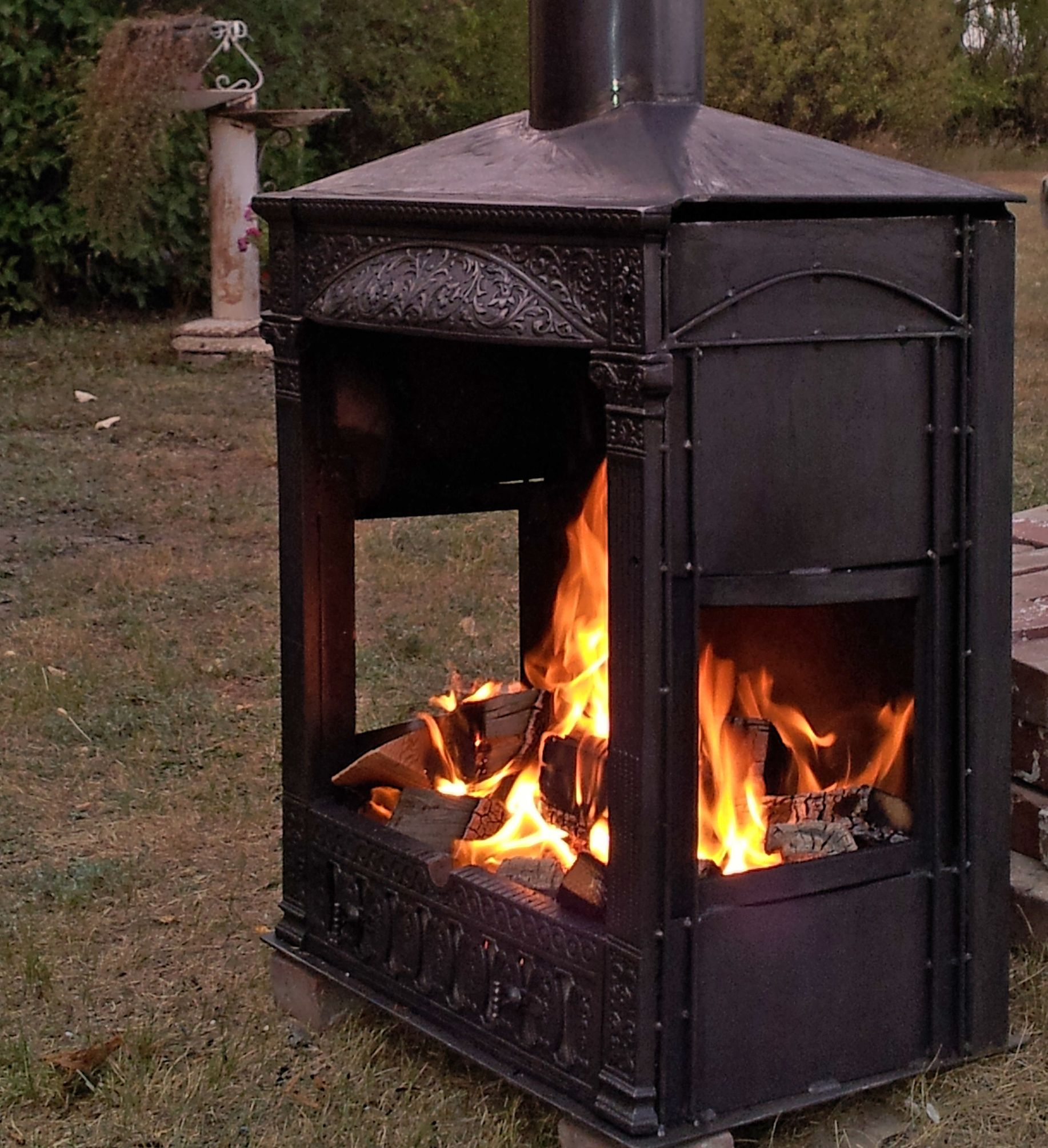This is an outdoor fireplace, built by welding an antique ...