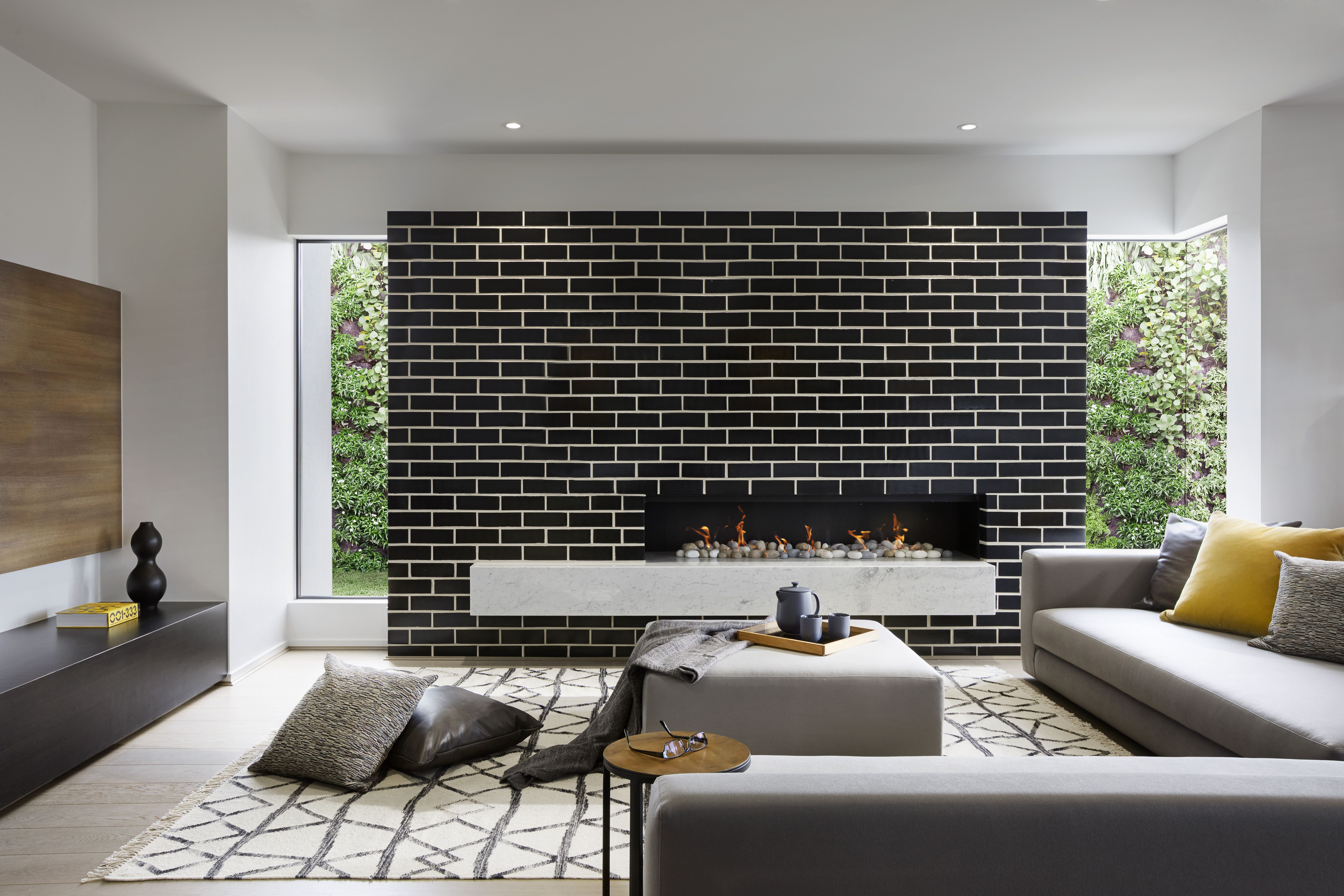 Make Your Feature Wall Modern Black Brick Paired With A L Windows Home Interior Interior Design