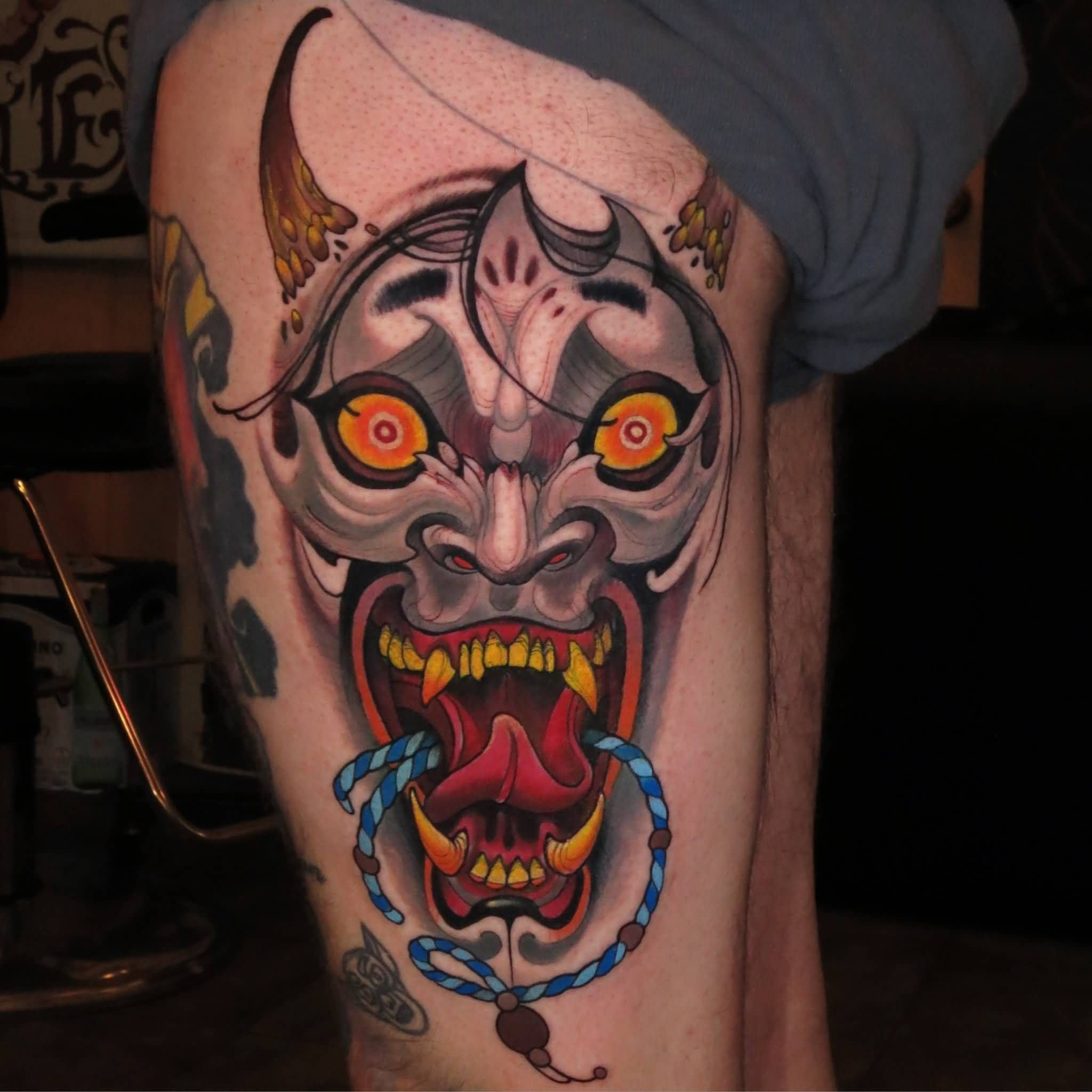 Traditional Hannya Mask Tattoo On Left Side Thigh By