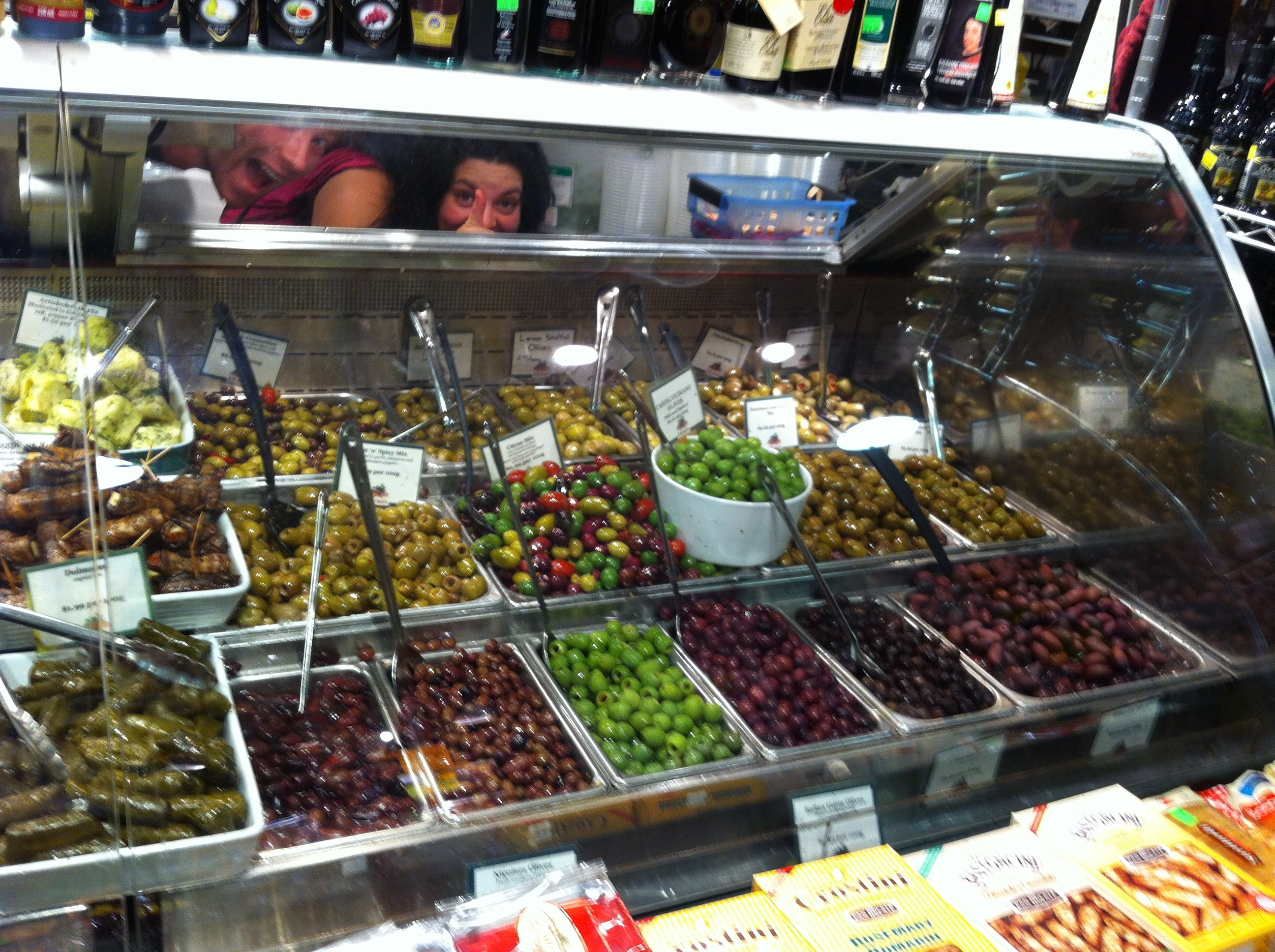 Granville Island Marketplace; check out those merry faces behind the olive display.  And yes, my mouth was watering at this counter too.