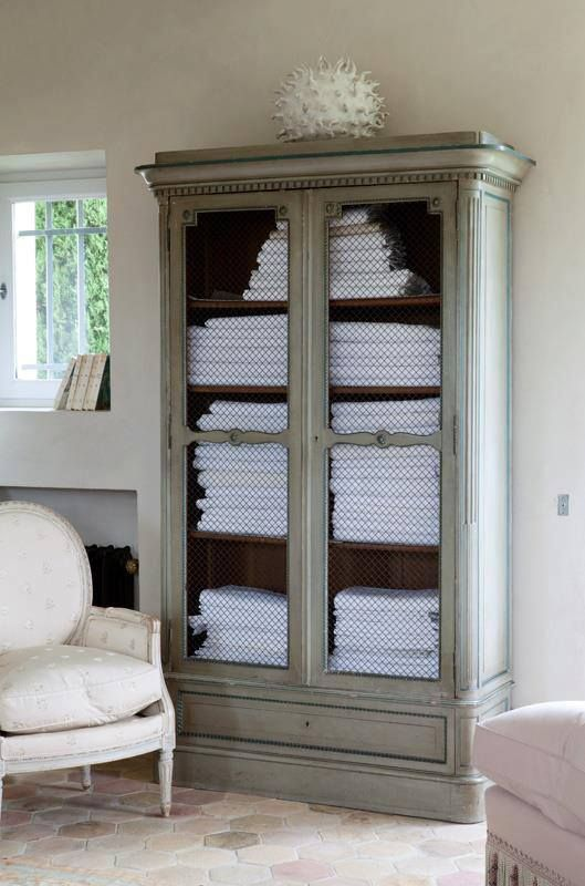 Towel Cabinet With Chicken Wire Door Panels In Master Bath Home