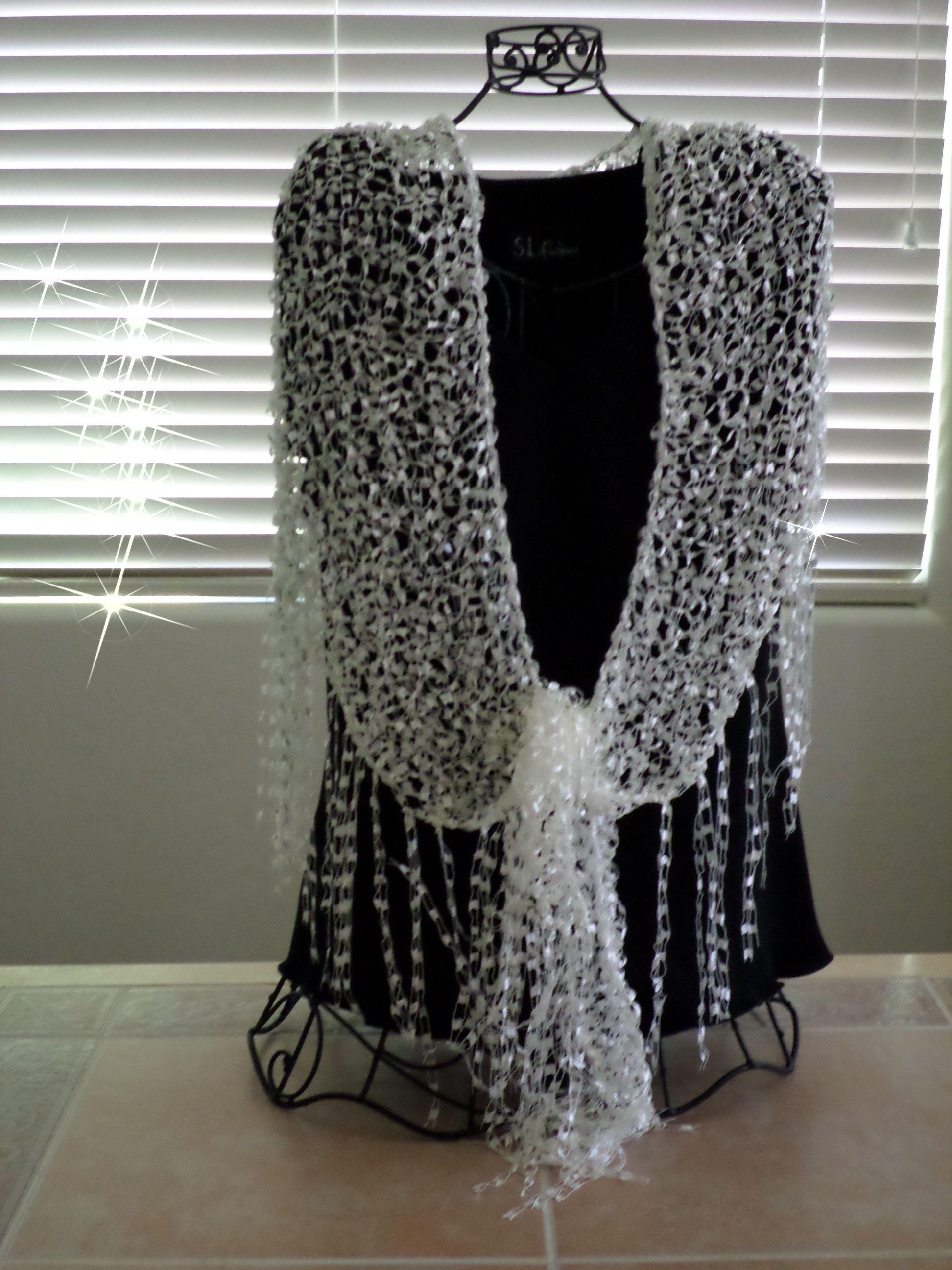 Elegant shawl/wrap. Hand knitted of Trellis/ladder/ribbon yarn ...