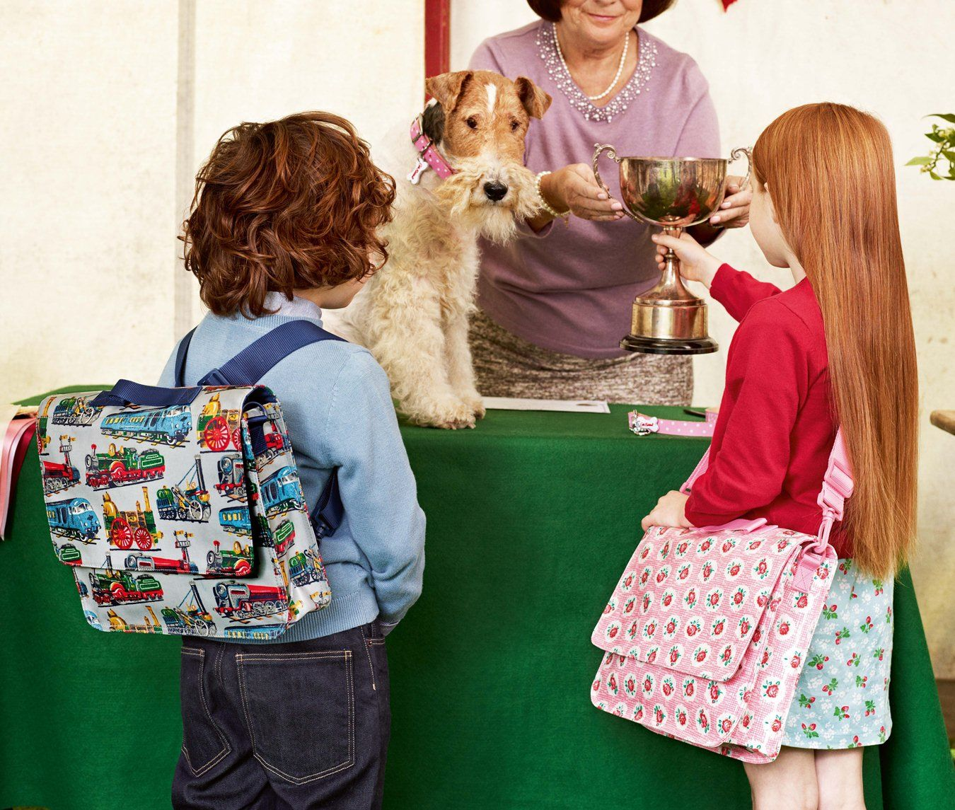 Trains grey school satchel | Lattice rose pink school satchel. From Cath Kidston's BEST IN SHOW: Spring 2013 #spring #fashion #kids #bags #dogs