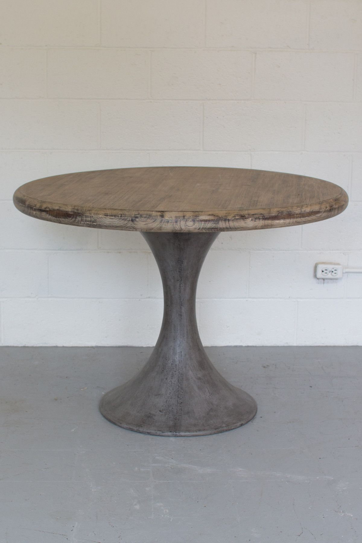 Pairing A Solid Concrete Pedestal Base And Round Acacia Wood Dining Top This