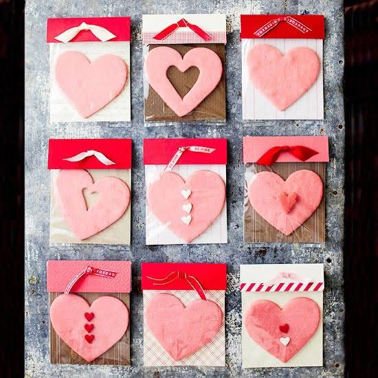 Super cute valentine idea! Heart shaped cookies inside a clear cellophane bag with decorative card stock backing. Fold extra card stock over top of bag, hole punch and tie with ribbon!