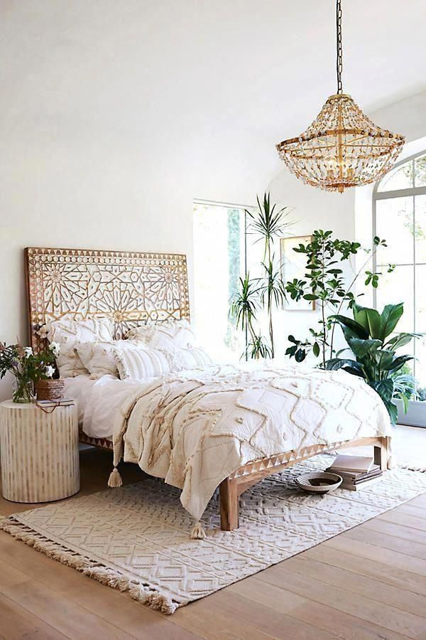 Photo of Moroccan pompom blanket King Bed size.
